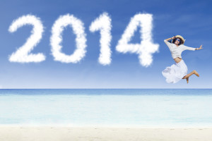 Woman jumping with clouds of 2014